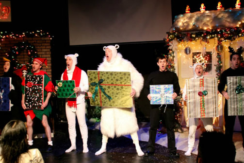 The cast of Santasia performs a musical number.
